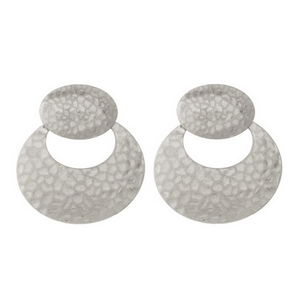 """Silver tone post style earrings with a hammered texture and an oval shape. Approximately 1.5"""" in length."""