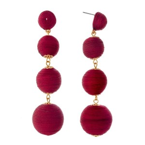 """Burgundy thread wrapped ball earrings with gold tone accents. Approximately 3.5"""" in length."""