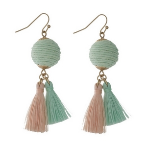 """Gold tone fishhook earrings with a mint green thread wrapped ball and two thread tassels. Approximately 2"""" in length."""