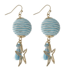 """Gold tone fishhook earrings with a light blue and ivory thread wrapped ball bead and a starfish charm. Approximately 2"""" in length."""