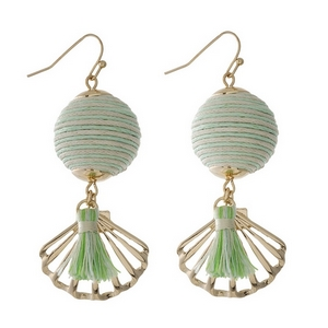 "Gold tone fishhook earrings with a mint green and ivory thread wrapped ball bead and a seashell charm. Approximately 2"" in length."