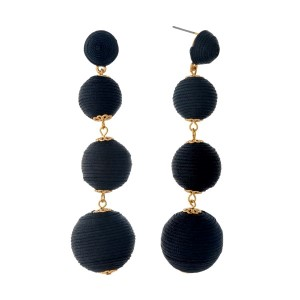 """Black thread wrapped ball earrings with gold tone accents. Approximately 3.5"""" in length."""