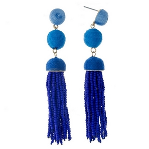"""Gold tone stud earrings with blue ombre thread wrapped beads and a blue tassel. Approximately 3.5"""" in length."""