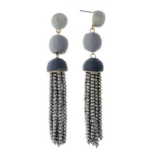 """Gold tone stud earrings with black ombre thread wrapped beads and a hematite tassel. Approximately 3.5"""" in length."""