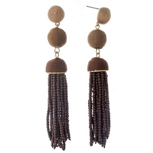 """Gold tone stud earrings with brown ombre thread wrapped beads and a brown tassel. Approximately 3.5"""" in length."""