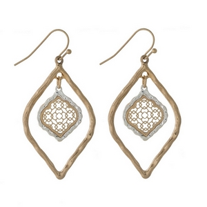 """Gold tone fishhook earrings with a two tone filigree oval shape. Approximately 1.5"""" in length."""