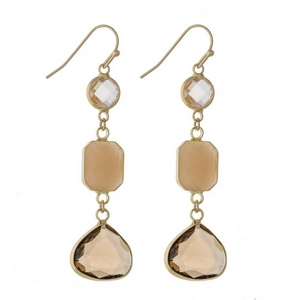 """Gold tone fishhook earrings with three faceted topaz stones. Approximately 2"""" in length."""