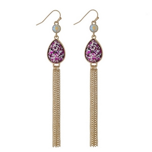 """Gold tone fishhook earrings with a fuchsia glitter teardrop and chain tassel. Approximately 4"""" in length."""