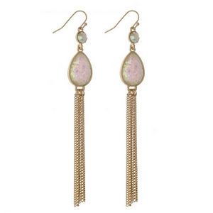 """Gold tone fishhook earrings with a white glitter teardrop and chain tassel. Approximately 4"""" in length."""