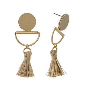 "Gold tone stud earrings with a beige faux leather circle and a thread tassel. Approximately 2"" in length."