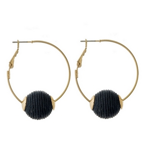 """Gold tone hoop earrings with a lever back and a black thread wrapped bead. Approximately 1.5"""" in diameter."""
