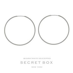 """Secret Box 24 karat white gold dipped over brass hoop earrings. Approximately 1.75"""" in diameter."""