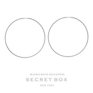"""Secret Box 24 karat white gold dipped over brass hoop earrings. Approximately 2.5"""" in diameter."""