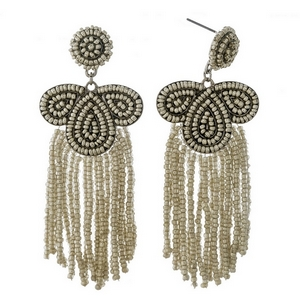 "Silver beaded statement earrings with beaded fringe. Approximately 3.25"" in length."