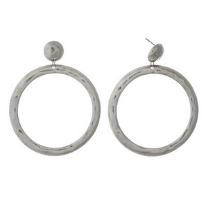 "Hammered silver tone stud earrings with an open circle shape. Approximately 2.75"" in length."