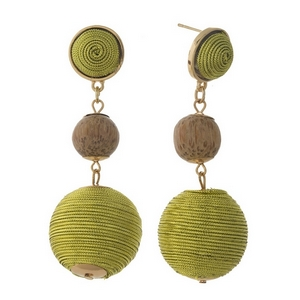 """Gold tone post style earrings with two metallic gold thread wrapped beads and a wooden bead. Approximately 2.75"""" in length."""