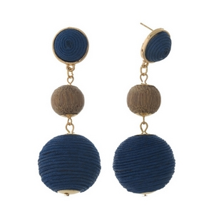"""Gold tone post style earrings with two navy blue thread wrapped beads and a wooden bead. Approximately 2.75"""" in length."""
