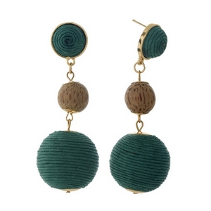 """Gold tone post style earrings with two green thread wrapped beads and a wooden bead. Approximately 2.75"""" in length."""