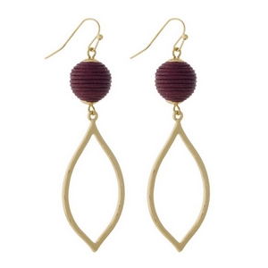 "Gold tone fishhook earrings with a burgundy thread wrapped bead and an open teardrop shape. Approximately 2.5"" in length."