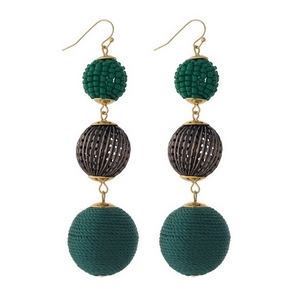 """Gold tone fishhook earrings with green thread wrapped and beaded, beads. Approximately 3.5"""" in length."""