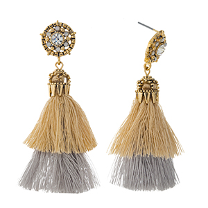 "Gold tone post style earrings with a layered gray and beige thread tassel. Approximately 2.5"" in length."