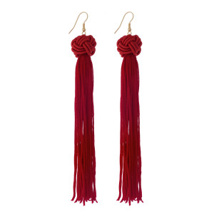 "Gold tone fishhook earrings with a crimson knotted bead and thread tassel. Approximately 5"" in length."