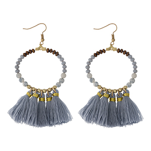 """Gold tone fishhook earrings with a natural stone beaded circle, accented with gray thread tassels. Approximately 3"""" in length."""