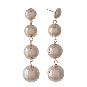 """Rose gold tone, four bead earrings. Approximately 3"""" in length."""