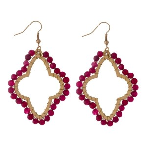 "Gold tone, open moroccan shaped, fishhook earrings with wire wrapped burgundy natural stones. Approximately 2"" in length."
