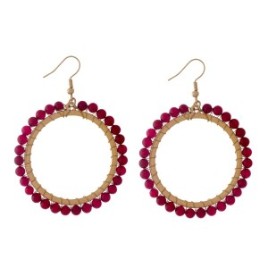 "Gold tone, open circle, fishhook earrings with wire wrapped burgundy natural stones. Approximately 2"" in diameter."