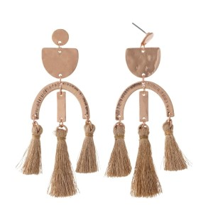 "Rose gold tone post style earrings with hammered geometric shapes and three tassels. Approximately 3.25"" in length."