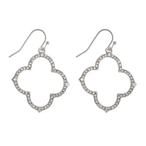 Silver tone clover shaped earrings with rhinestone details.