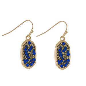 """Gold tone fishhook earrings with a royal blue rhinestone oval shape. Approximately 1"""" in length."""
