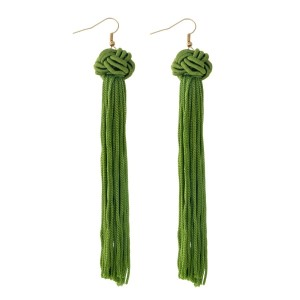 "Gold tone fishhook earrings with an olive green knotted bead and thread tassel. Approximately 5"" in length."