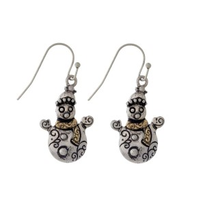"Silver tone fishhook earrings with a two tone snowman. Approximately 1"" in length."