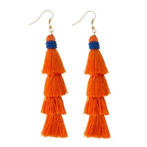 "Orange, tiered tassel earring with royal blue beaded accents. Approximately 3.5"" in length."