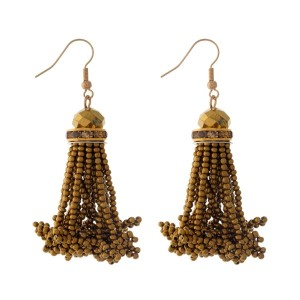 "Gold tone fishhook earrings with a bronze, seed-bead tassel. Approximately 2"" in length."