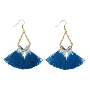 "Burnished gold tone fishhook earrings with blue, thread, fan tassels and rhinestone accents. Approximately 2.5"" in length."