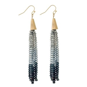 "Gold tone fishhook earrings with an ombre, beaded tassel. Approximately 3.5"" in length."