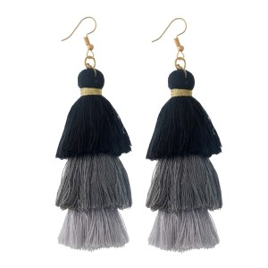 "Gold tone fishhook earrings with black to gray, ombre, tiered tassels. Approximately 3"" in length."