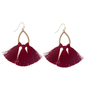 "Gold tone fishhook earrings with an open teardrop shape and burgundy thread tassels. Approximately 2.5"" in length."