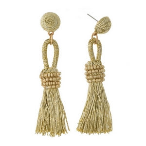"Stud earrings with a metallic, thread wrapped bead and a metallic thread tassel. Approximately 3"" in length."