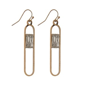 """Two tone, fishhook earrings with an oval shape and wire wrapping detail. Approximately 2"""" in length."""