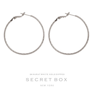 """Secret Box 24 karat white gold over brass twisted hoop earrings with a lever back. Approximately 1.5"""" in diameter."""