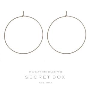 """Secret Box 24 karat white gold over brass dainty hoop earrings. Approximately 1.5""""d in diameter."""