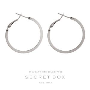 """Secret Box 24 karat white gold over brass hoop earrings. Approximately 1"""" in diameter."""