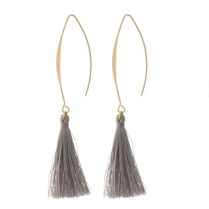 """Gold tone, long hook earrings with a thread tassel. Approximately 3"""" in length."""
