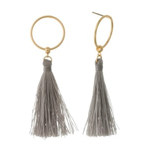 "Gold tone stud earrings with an open circle and a thread tassel. Approximately 2.5"" in length."