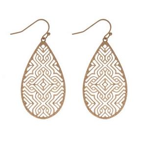 "Dainty gold tone fishhook earrings with a laser cut design on a teardrop shape. Approximately 2"" in length."
