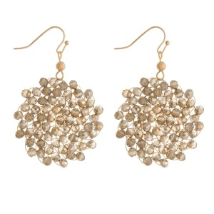 """Gold tone fishhook earrings with a wire wrapped, beaded circle. Approximately 2"""" in length."""